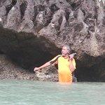 Photographer around a rock