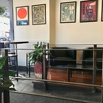 Band posters and seating area