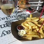 French fries and a glass of wine