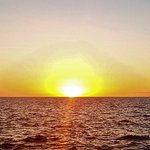 Catch the sunset during the surface interval before the night manta dive