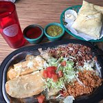 Tamale, veggie enchilada, pinto beans, rice and chicken sopapilla-- on the side red and green