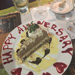 Nice touch - slice of walnut cake for our anniversary