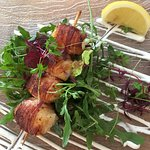 Grilled bacon wrapped scallops with a light Caesar dressing
