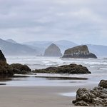 View from Crescent Beach of Cannon Beach and the mountains.