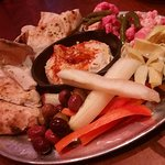 Hummus platter with made to order pita, olives & veggie assortment