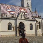 Luka passionately explaining what the symbols on the St. Mark's church mean.