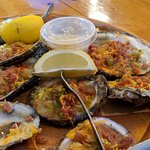 Oysters baked with bacon, cheese and jalapenos. Delicious!