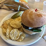 Burger with sale and pepper chips