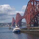 forth bridge showing boat used for river cruise