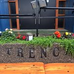 Bench at front of Trench Brewery and Distillery entry