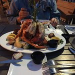 seafood platter for 2,bed of rice and veg.,large lobsters tails,alaska crab legs,scallops,shrimp