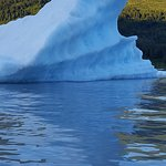 kayaking by chucks of blue iceberg