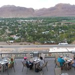 Outdoor patio seating and view to red rock cliffs to the west