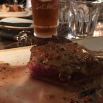 Rare steak with Pepercorn source.