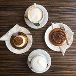 choux, chocolate cake and cappucino
