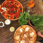 PIZZA WITH STRACIATTELLA MOZZARELLA AND PIZZA WITH SALMON