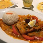 Corvina (cod) over vegetables with rice
