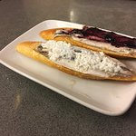 Anchovies with coconut and berries