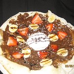 Nutella and banana with strawberry dessert pizza.