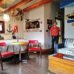 Spacious Boathouse room, 'kitchen' nook and washroom behind my husband.