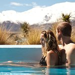 Hot pools with snowy mountains