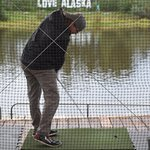 Try your hand at hitting a golf ball across the river
