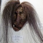 """Shaman"" fossilized whale bone mask by Chuck Leake."