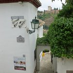 The entrance with the Alhambra in the background