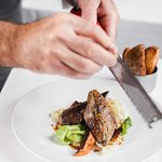 Rhug Estate Grouse 'off the bone' white bean purée hispi cabbage, triple cooked potato, game jus