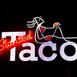 Slanted Taco Sign on wall