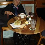 Marilyn tucking into Seafood Chowder and my Cottage Pie in the forfront