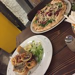 Fried fish and bressaola pizza
