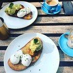 smash avocado toast with poached eggs