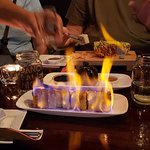 Sushi roll flamed at our table! Wow!
