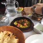 peshwari naan, pilau rice, chicken tikka and chicken dompukta.