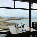 View from our table overlooking Mumbles lighthouse and Bracelet Bay