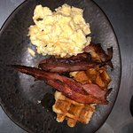 The American. Deliciously sweet waffles, streaky bacon and fluffy scrambles eggs.