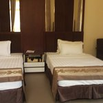 well furnished twin bed bedrooms with large windows.