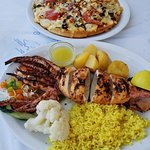 Excellent grilled squid and the Greek pizza.