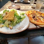 Small pizza with mushrooms and salad