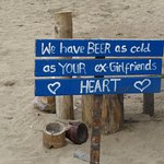 very funny sign on the beach