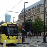 All cities shoudl have a tram network like Machester. This photo shows Manchester city hall.