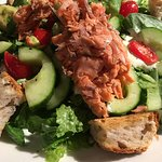 Alaskan Salmon BLT Salad with house-smoked salmon, baby spinach and house-made croutons.