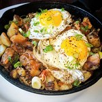Beef brisket hash with potatoes, spring onions and sunny side up eggs. Finger licking delicious!