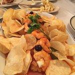 Cod fish Portugalia style, restaurant signature dish, delicious.