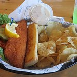 Fish sandwich with potato chips