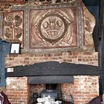 The old mural coat of arms above the fireplace