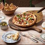 Publico Seven Cereali Pizza - multigrain flour base, tomato sauce, roasted seasonal roots