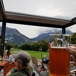 A view of Neuschwanstein from the restaurant with a beer.