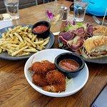 Fries, coconut prawns and chicken sandwich (?)